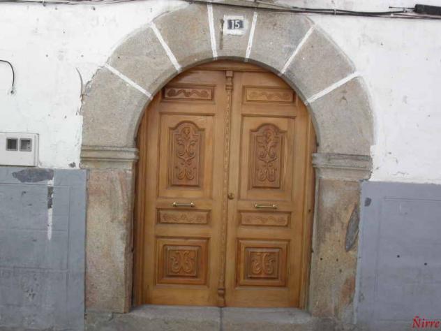 Puerta arco en piedra de granito jaraiz de la vera for Las puertas de piedra amazon